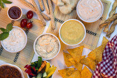 Food - Party Dips - Bread Sticks. A selection of party dips with bread sticks, pita bread and other crudites royalty free stock photos