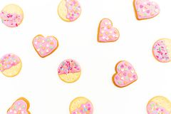 Food pattern made of pink gingerbread cookies isolated on white background. Flat lay. top view. Food pattern made of pink gingerbread cookies isolated on white Royalty Free Stock Photos