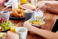 Hands of woman eating cereals for breakfast Royalty Free Stock Photos