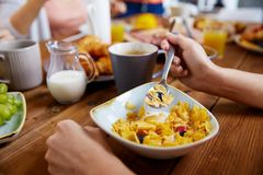 Hands of woman eating cereals for breakfast Stock Image