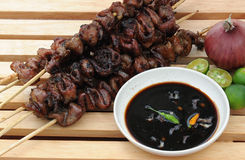 "Food from the Philippines, Inihaw Na Bituka Ng Baboy (Grilled Pork Intestines). ""Inihaw Na Bituka ng Baboy"" also called ""Gulong"" and ""Pork Isaw"" in stock image"