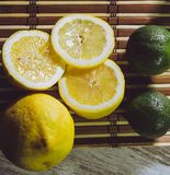 Lime and lemon splash with ice and some detox water. Food photo of fresh lime and lemons. This is perfect for background or magazines related to food and kitchen stock images