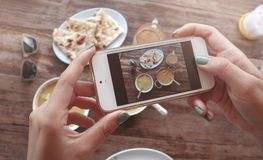 Food photo of indian food on wooden table for social networks. Home made food photo for social networks. Top view mobile phone photo of indian food stock photography
