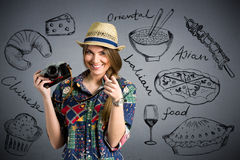 Food photographer - Nice female tourist with draw different type. S of food in background stock image