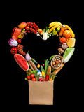 Food photography of heart made from different vegetables on black background. royalty free stock image