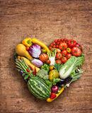 Food photography of heart made from different vegetables on wooden table. Heart symbol. Vegetables diet concept. Food photography of heart made from different Royalty Free Stock Photography