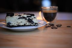 Food photography of homemade chocolate biscuit cheesecake with love heart decorations and blur background cup of coffee Royalty Free Stock Image