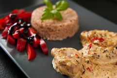 Pork fillets with rice and peppers. Stock Photo