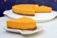 Slice of homemade orange cream pumpkin cake on plate stock images