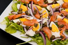 Eggs salad with salmon and capers Stock Photography