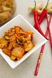 White bowl of Korean kimchi food with chopsticks Royalty Free Stock Photos