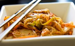 White bowl of Korean kimchi food with chopsticks Stock Image