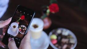 Food photography. Woman photographing coffee on phone closeup