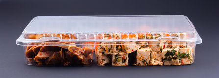 Food in a plastic container. On a dark background Stock Photos