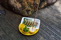 Food in plastic tray for sacrifice to the wandering spirit Royalty Free Stock Photo