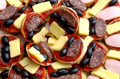 Food plate. With olives,sausages and yellow cheese Stock Images