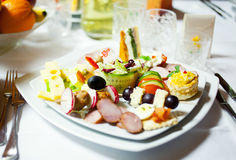 Food plate at ceremony. Usual food plate at ceremony Royalty Free Stock Images