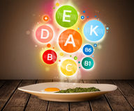 Food plate with delicious meal and healthy vitamin symbols Stock Images