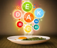 Food plate with delicious meal and healthy vitamin symbols Stock Photo