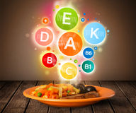 Food plate with delicious meal and healthy vitamin symbols Royalty Free Stock Photos