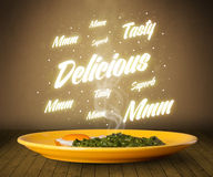 Food plate with delicious and tasty glowing writings Royalty Free Stock Image