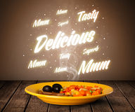 Food plate with delicious and tasty glowing writings Stock Photos