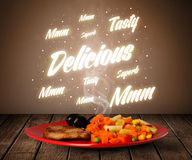 Food plate with delicious and tasty glowing writings Stock Photo