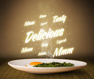 Food plate with delicious and tasty glowing writings Royalty Free Stock Photo