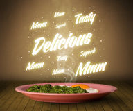 Food plate with delicious and tasty glowing writings Stock Image