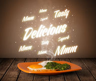 Food plate with delicious and tasty glowing writings Royalty Free Stock Photos