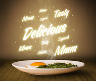 Food plate with delicious and tasty glowing writings Stock Photography