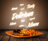 Food plate with delicious and tasty glowing writings Stock Images
