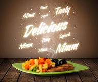 Food plate with delicious and tasty glowing writings Royalty Free Stock Images