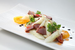 Food. A plate of roasted duck with salad Stock Photo