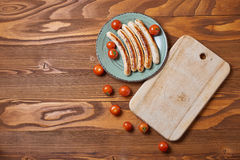 Food plate of traditional german fried sausages with beer and to Stock Images