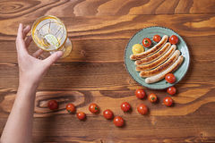 Food plate of traditional german fried sausages with beer and to Stock Photos