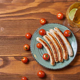Food plate of traditional german fried sausages with beer and to Royalty Free Stock Images