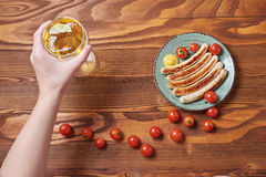 Food plate of traditional german fried sausages with beer and to Stock Photography