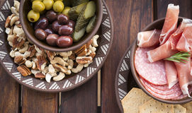 Food Platters. Classic antipasto food platters typical of the Mediterranean including olives, salami, crackers Royalty Free Stock Photography