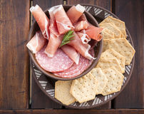 Food Platters. Classic antipasto food platters typical of the Mediterranean including salami and crackers Stock Photos