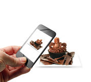 Food Porn. Someone taking a food selfie with a mobile device. A trend in restaurants causing controversy with chefs as images are posted on social networks by Stock Image
