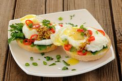 Food porn poached egg sandwiches with chili and scallion. Closeup Stock Photography