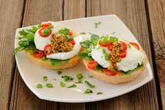 Food porn poached egg sandwiches with chili and scallion. Closeup Royalty Free Stock Photography