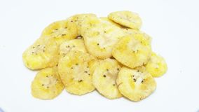 Dried banana chips on background - healthy fruit food royalty free stock photos