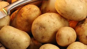 Food - Potato. The Potato is a starchy plant tuber which is one of the most important food crops, cooked and eaten as a vegetable stock video footage