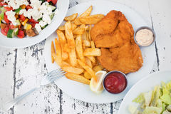 Food with potatoes, chicken schnitzel and salads Royalty Free Stock Photo