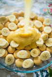 A food preparation action shot with bananas and toffee Stock Photo