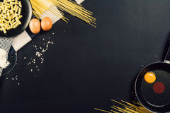 Food preparation background with pasta ingredients. Top view. Royalty Free Stock Photo