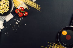 Food preparation background with pasta ingredients. Top view. Stock Photos