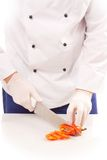 Chef cutting bell peppers Stock Photos